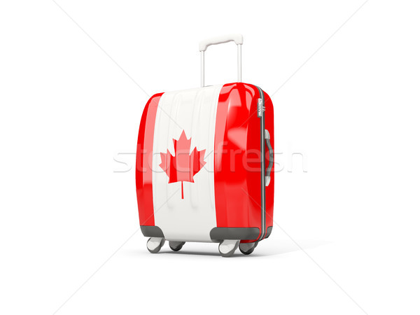 Luggage with flag of canada. Suitcase isolated on white Stock photo © MikhailMishchenko