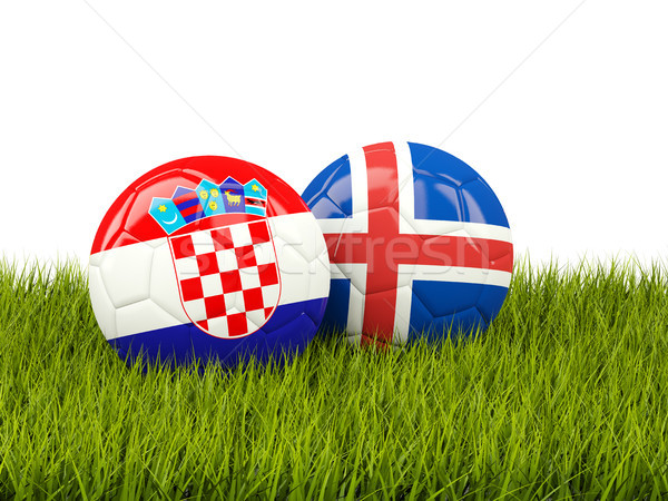 Croatia vs Iceland. Soccer concept. Footballs with flags on gree Stock photo © MikhailMishchenko