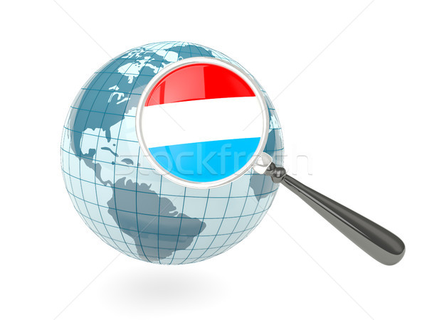 Magnified flag of luxembourg with blue globe Stock photo © MikhailMishchenko