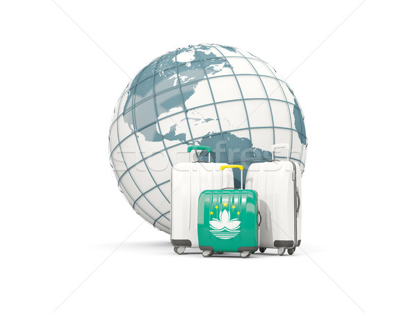 Luggage with flag of macao. Three bags in front of globe Stock photo © MikhailMishchenko