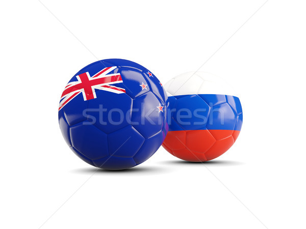 Two footballs with flags of New Zealand and Russia isolated on w Stock photo © MikhailMishchenko