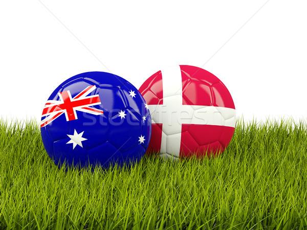 Australie vs Danemark football drapeaux herbe verte Photo stock © MikhailMishchenko