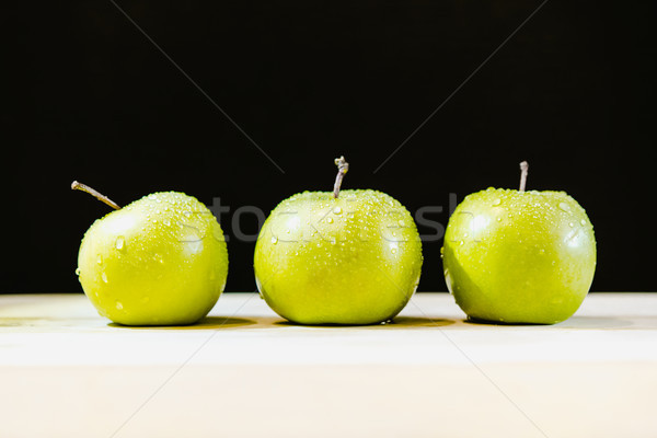 Three apples in a row with drops of water Stock photo © MikhailMishchenko
