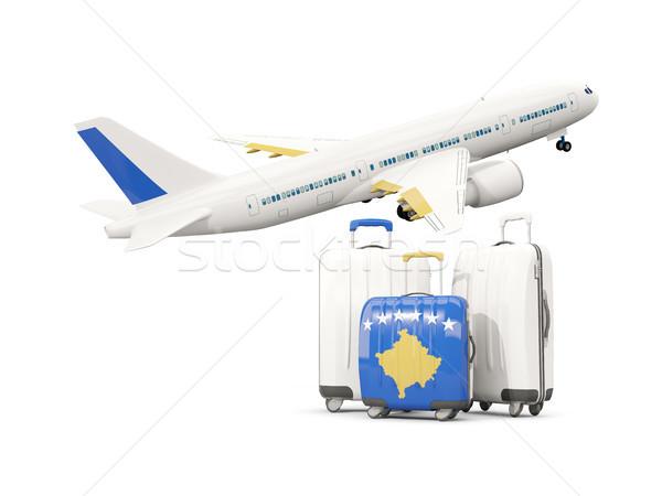 Luggage with flag of kosovo. Three bags with airplane Stock photo © MikhailMishchenko