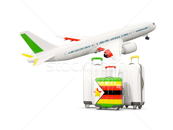 Luggage with flag of zimbabwe. Three bags with airplane Stock photo © MikhailMishchenko