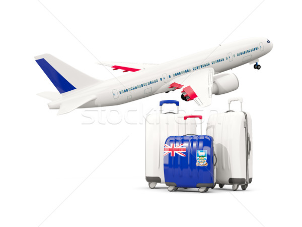 Luggage with flag of falkland islands. Three bags with airplane Stock photo © MikhailMishchenko