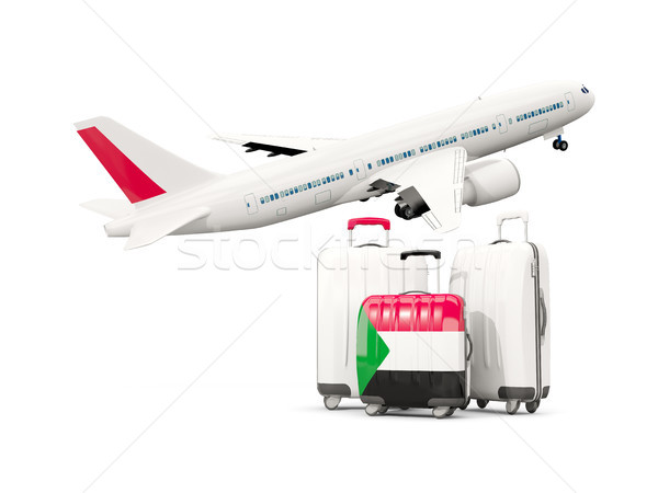 Luggage with flag of sudan. Three bags with airplane Stock photo © MikhailMishchenko