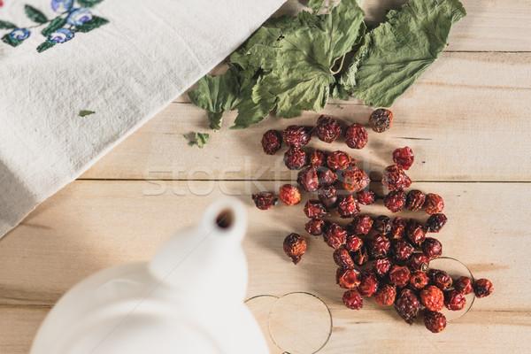 Rose Hip herbal tea on wooden background Stock photo © MikhailMishchenko