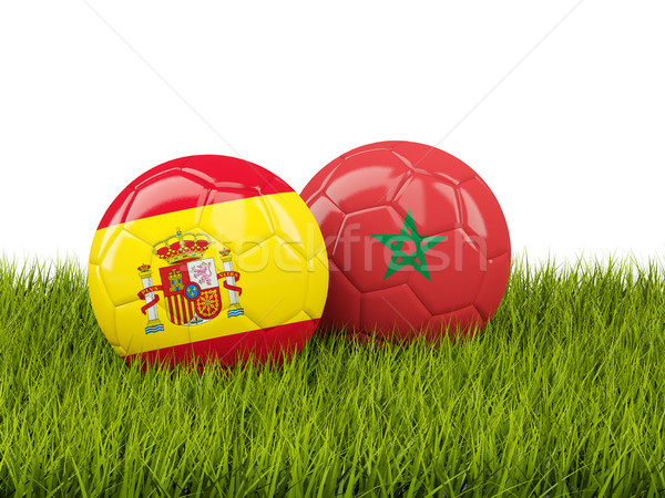 Spain vs Morocco. Soccer concept. Footballs with flags on green  Stock photo © MikhailMishchenko