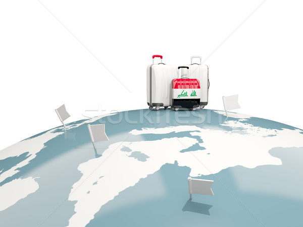 Luggage with flag of iraq. Three bags on top of globe Stock photo © MikhailMishchenko