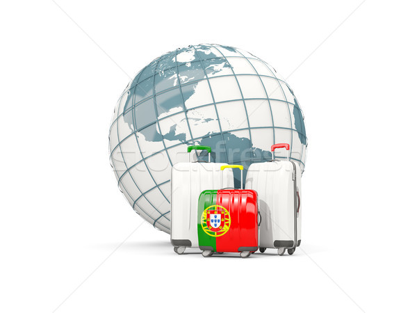 Luggage with flag of portugal. Three bags in front of globe Stock photo © MikhailMishchenko