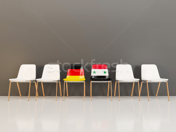 Chairs with flag of Germany and syria in a row Stock photo © MikhailMishchenko