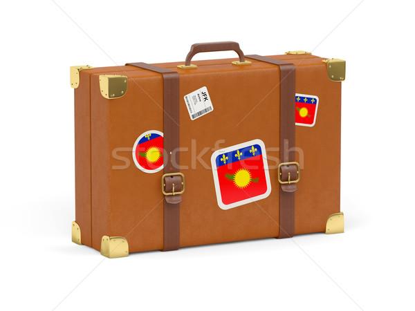 Suitcase with flag of guadeloupe Stock photo © MikhailMishchenko
