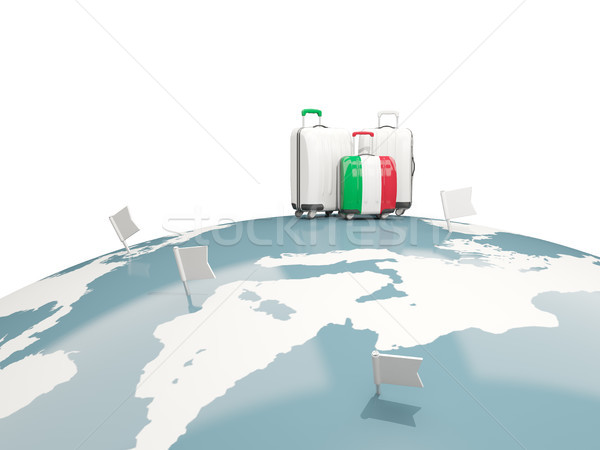 Luggage with flag of italy. Three bags on top of globe Stock photo © MikhailMishchenko