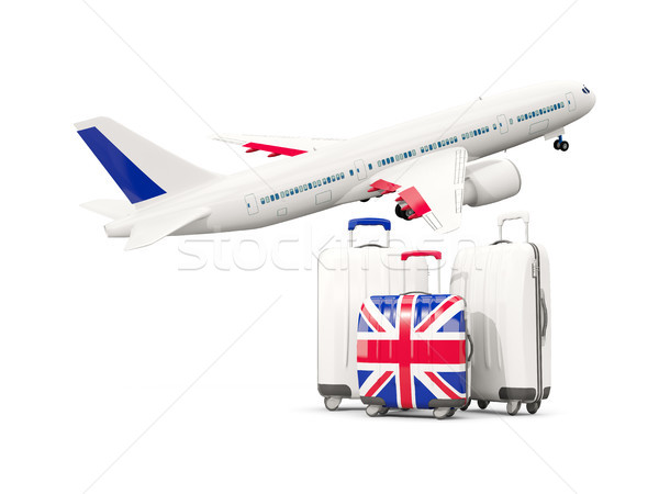 Bagages pavillon uni trois sacs avion Photo stock © MikhailMishchenko