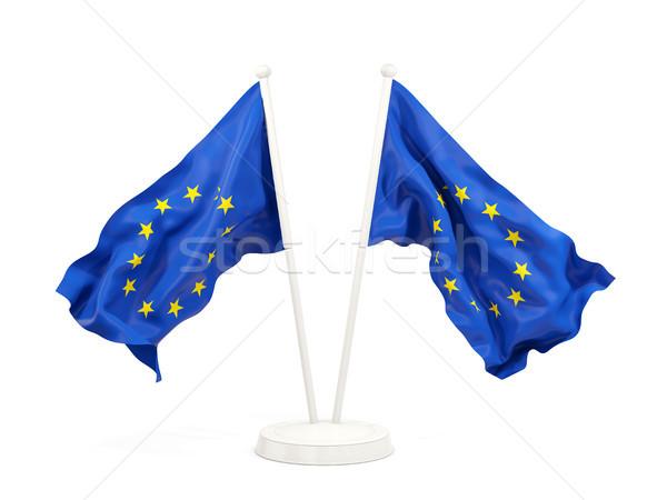 Two waving flags of european union Stock photo © MikhailMishchenko