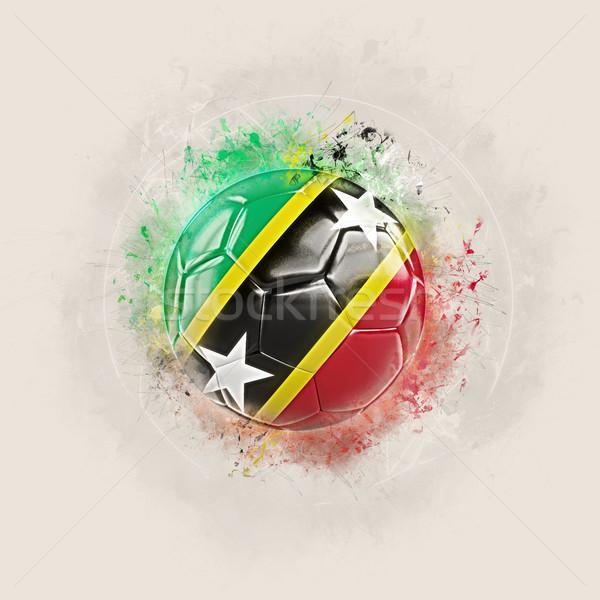 Grunge football with flag of saint kitts and nevis Stock photo © MikhailMishchenko