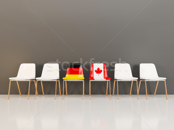Chairs with flag of Germany and canada in a row Stock photo © MikhailMishchenko