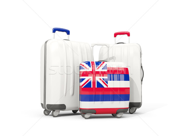 Luggage with flag of hawaii. Three bags with united states local Stock photo © MikhailMishchenko