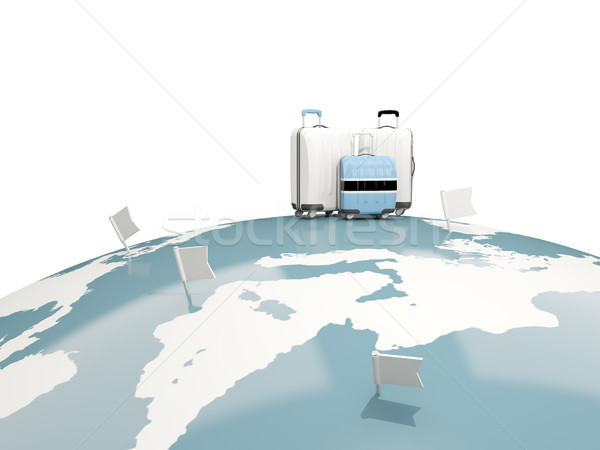 Stock photo: Luggage with flag of botswana. Three bags on top of globe