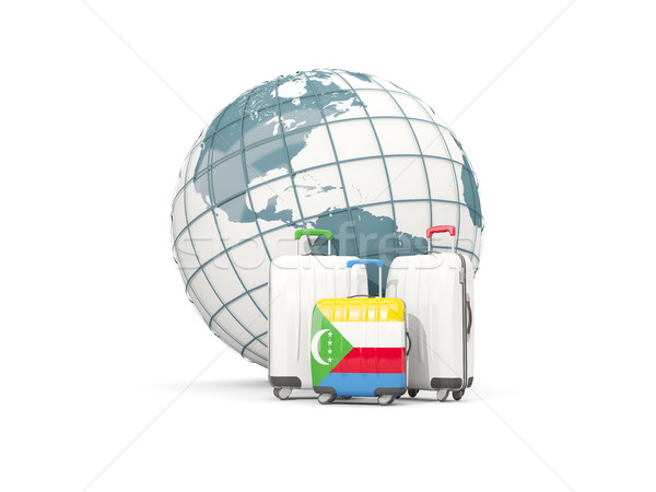 Luggage with flag of comoros. Three bags in front of globe Stock photo © MikhailMishchenko