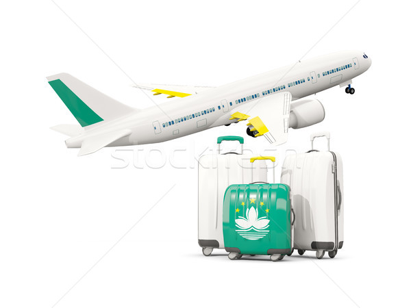 Luggage with flag of macao. Three bags with airplane Stock photo © MikhailMishchenko