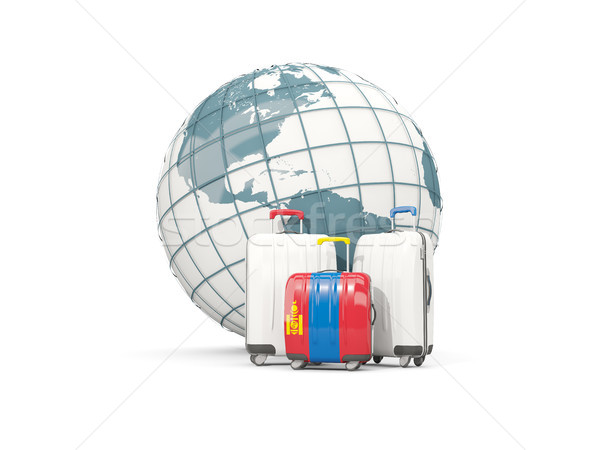Luggage with flag of mongolia. Three bags in front of globe Stock photo © MikhailMishchenko