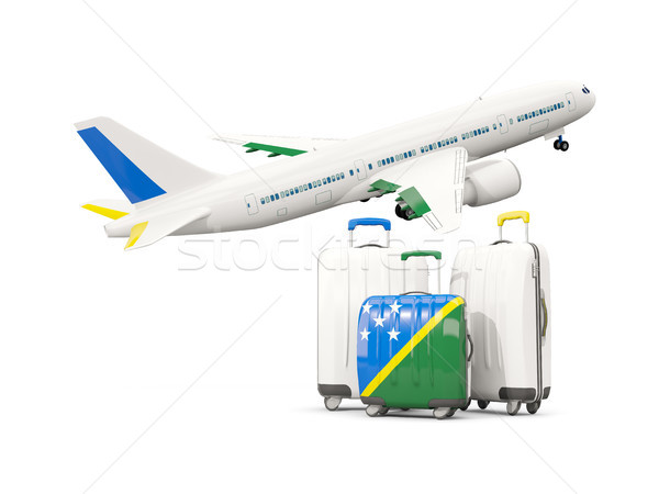 Luggage with flag of solomon islands. Three bags with airplane Stock photo © MikhailMishchenko
