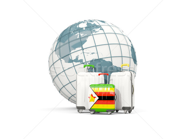 Luggage with flag of zimbabwe. Three bags in front of globe Stock photo © MikhailMishchenko