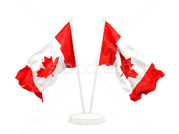 Two waving flags of canada Stock photo © MikhailMishchenko