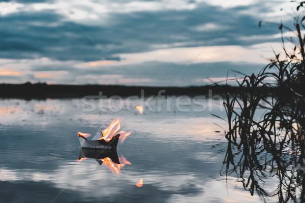 White paper boat on fire Stock photo © MikhailMishchenko