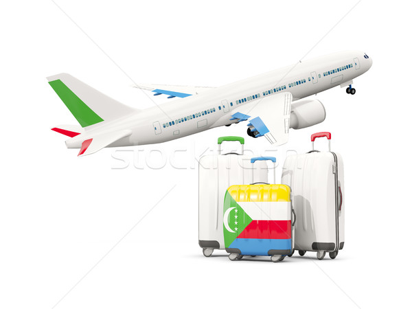Luggage with flag of comoros. Three bags with airplane Stock photo © MikhailMishchenko