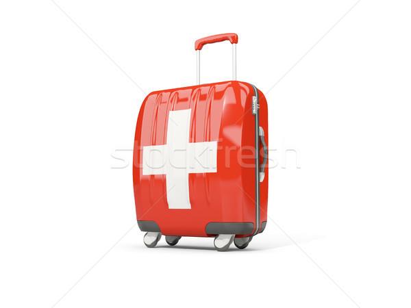 Luggage with flag of switzerland. Suitcase isolated on white Stock photo © MikhailMishchenko