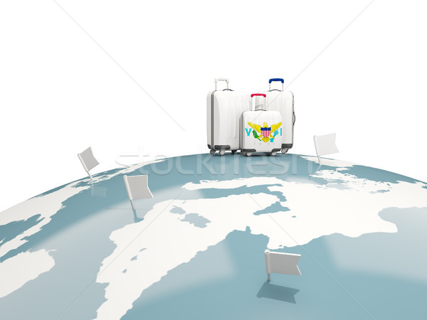 Luggage with flag of virgin islands us. Three bags on top of glo Stock photo © MikhailMishchenko