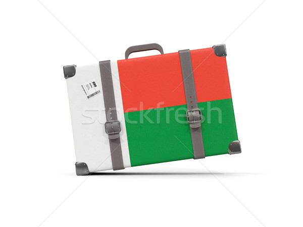 Luggage with flag of madagascar. Suitcase isolated on white Stock photo © MikhailMishchenko