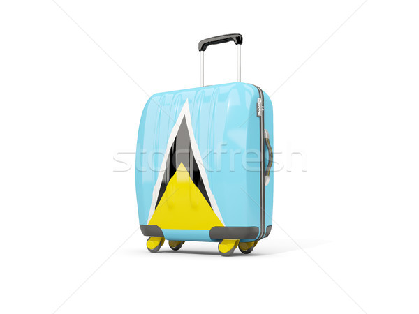 Luggage with flag of saint lucia. Suitcase isolated on white Stock photo © MikhailMishchenko
