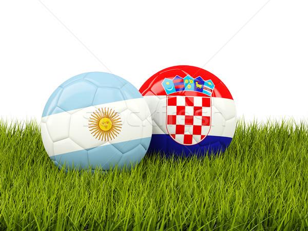 Argentine vs Croatie football drapeaux herbe verte Photo stock © MikhailMishchenko