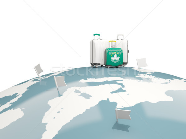 Luggage with flag of macao. Three bags on top of globe Stock photo © MikhailMishchenko