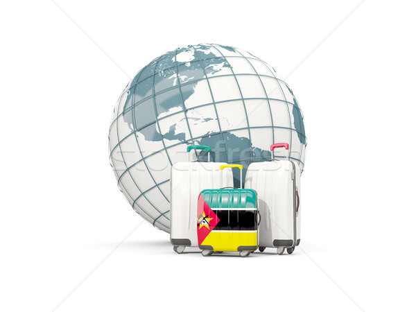 Luggage with flag of mozambique. Three bags in front of globe Stock photo © MikhailMishchenko