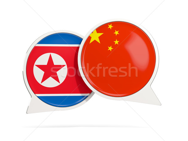 Chat bubbles with flags of China and North Korea Stock photo © MikhailMishchenko