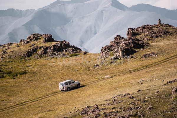 Car rides on top of the mountain. Alpine scenery at Altai Mounta Stock photo © MikhailMishchenko