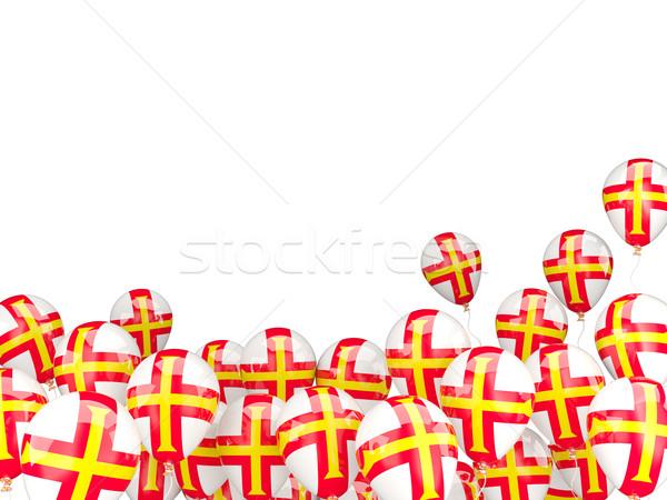 Flying balloons with flag of guernsey Stock photo © MikhailMishchenko