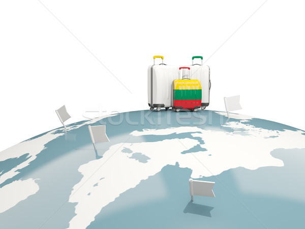 Luggage with flag of lithuania. Three bags on top of globe Stock photo © MikhailMishchenko