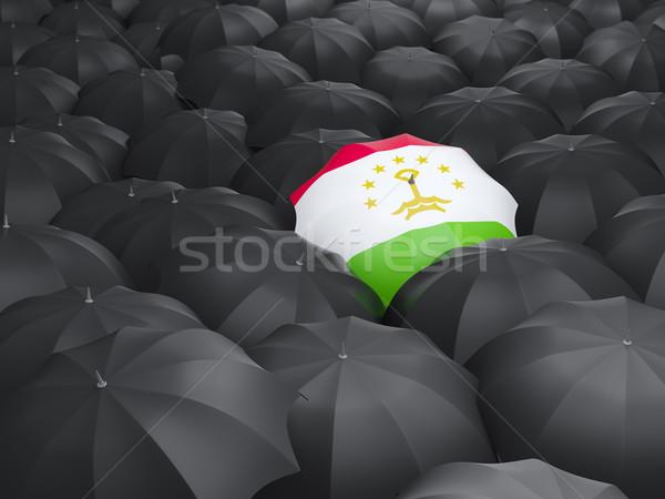 Umbrella with flag of tajikistan Stock photo © MikhailMishchenko