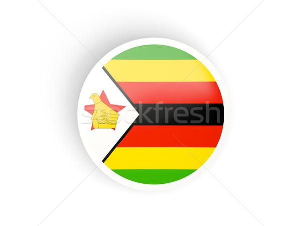 Adesivo bandiera Zimbabwe isolato bianco viaggio Foto d'archivio © MikhailMishchenko