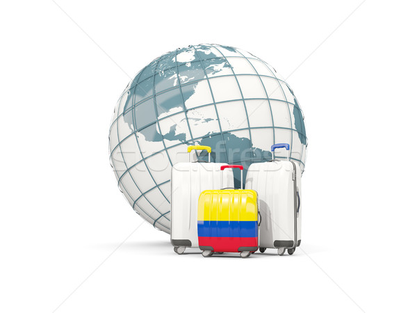 Luggage with flag of colombia. Three bags in front of globe Stock photo © MikhailMishchenko