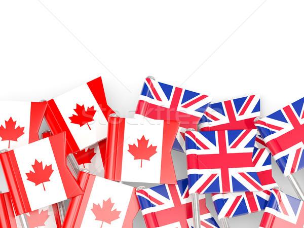 Flag pins of Canada and UK isolated on white. 3D illustration Stock photo © MikhailMishchenko