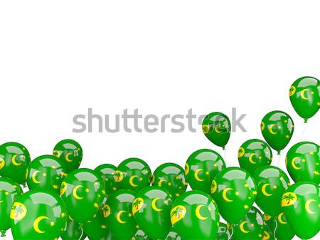 Flying balloons with flag of cocos islands Stock photo © MikhailMishchenko