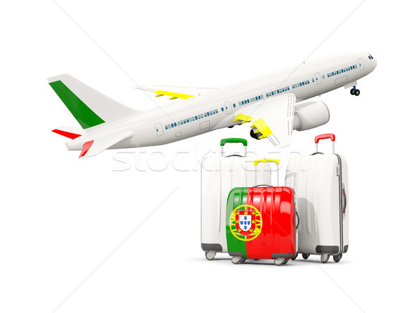 Luggage with flag of portugal. Three bags with airplane Stock photo © MikhailMishchenko