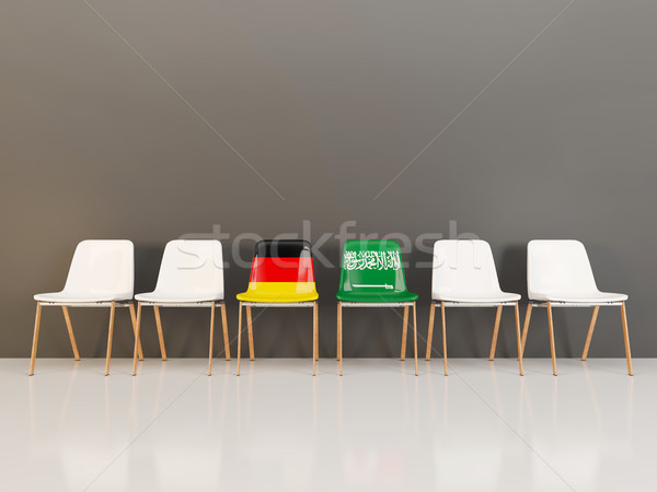 Chairs with flag of Germany and saudi arabia in a row Stock photo © MikhailMishchenko